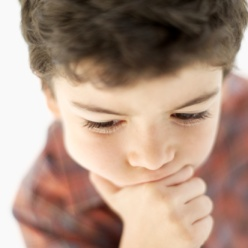 close-up of a boy in contemplation (6-7)