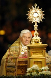 Pope Benedict XVI takes part in a candlelit Corpus Domini procession between the basilicas San Giovanni in Laterano and Santa Maria Maggiore in Rome