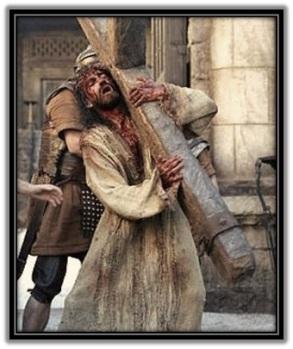 Jesús con la Cruz acuestas camino al Calvario