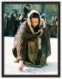 Jesús escribe en el suelo