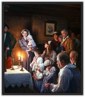Familia rezando el Rosario